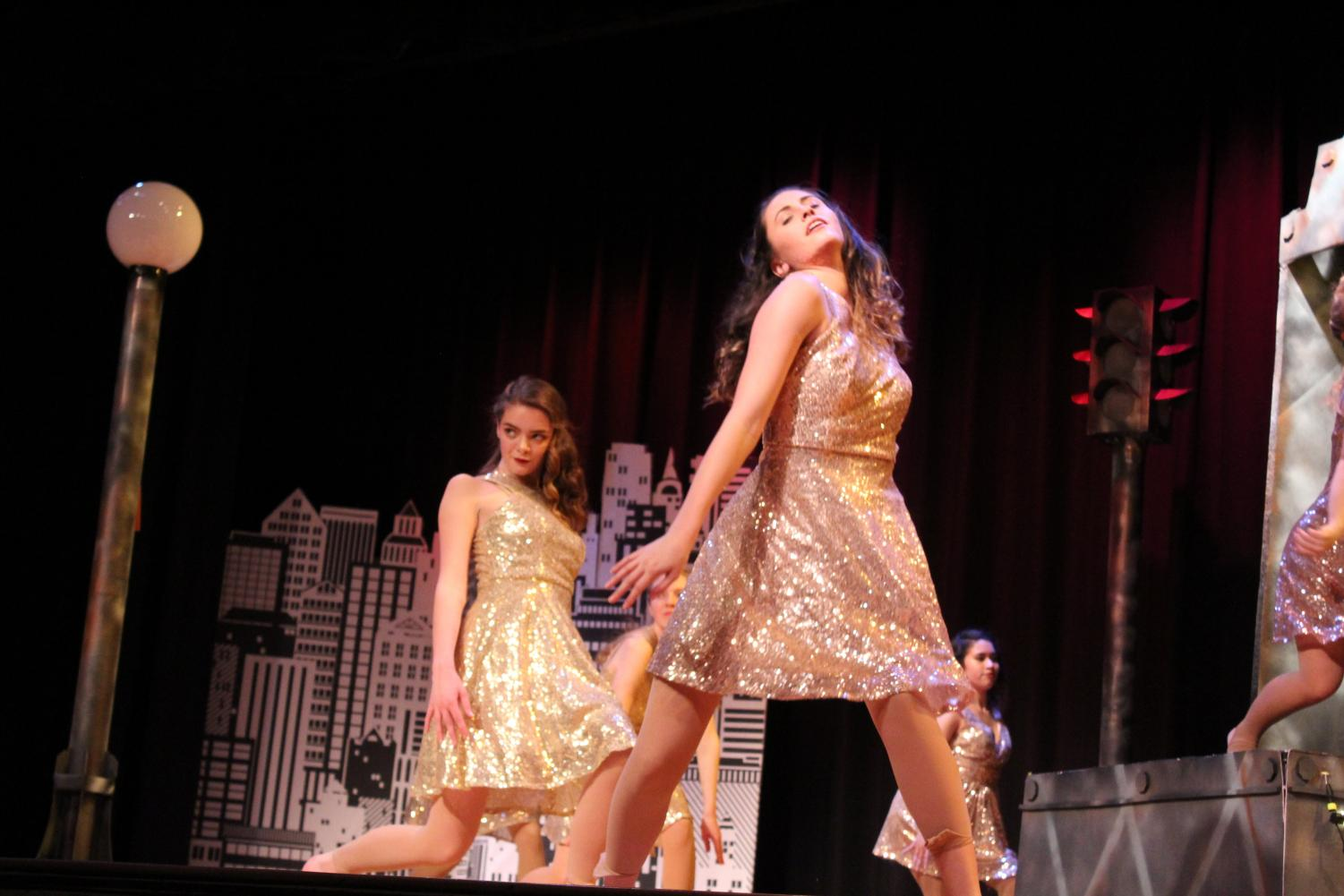 """Seniors Leah Whearty and Megan Mitchell pose during """"Noir."""""""
