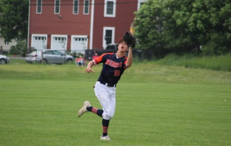 Junior outfielder, Will Jarvis, reaches for a pop fly hit to right field (Photo/Sarah St. George).