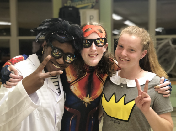 Students pose for a photo at the Best Buddies Halloween Dance.