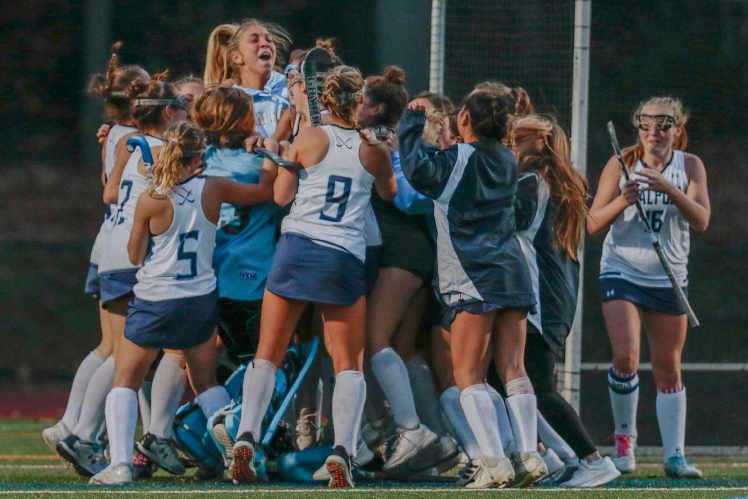 The Porkers erupt in cheers and share a group hug after beating Plymouth North 3-1.