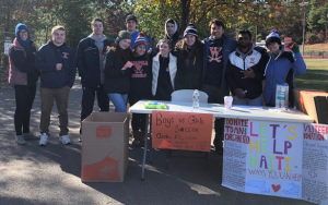 WHS Students Raise Money for Haiti Through a Soccer Game, Coin Drive and Shoe Collection