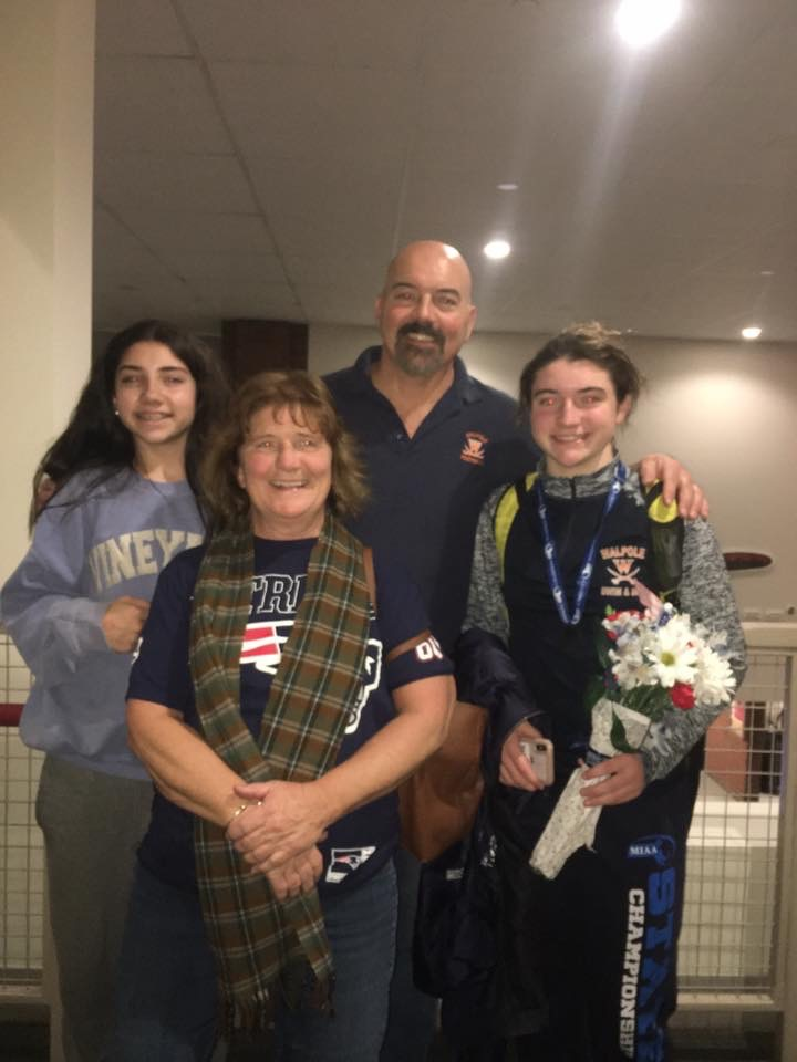 Melish poses with her family after her State Championship win.