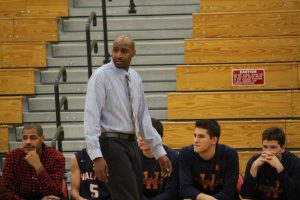 Oliver Vil Takes Over as New Head Boys Varsity Basketball Coach