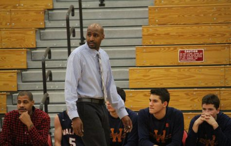 Vil coaches one of the varisty boys' basketball games during his first year at WHS.