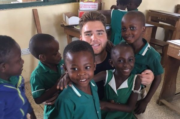 Ferraro spends time with young children in Ghana, where he spent this past summer.