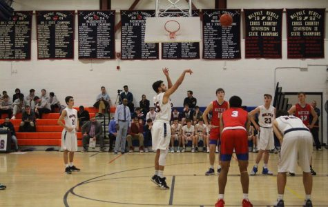 Boys Basketball Falls to Natick