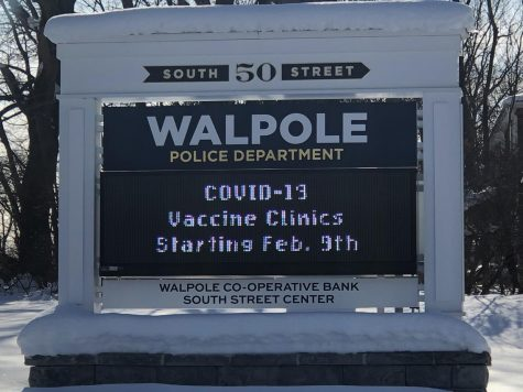 A banner outside of the Walpole Police Department.