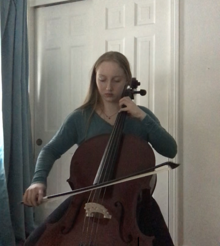 Pompeo playing cello for virtual audition.