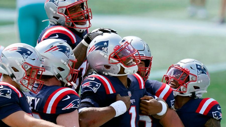 Quarterback Cam Newton celebrates after scoring his first touchdown with the Patriots, Sept. 13 2020