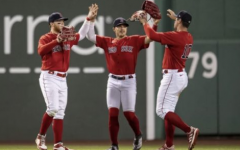 Hernandez (middle) celebrates in the outfield prior to the Red Soxs outbreak